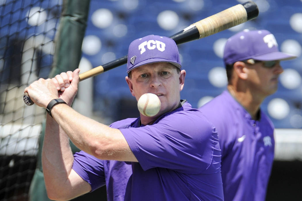 TCU coach Jim Schlossnagle hits a ball during practice at TD Ameritrade Park in Omaha, Neb., Friday, June 17, 2016. TCU will play Texas Tech on Sunday in the NCAA men's baseball College World Seri ...