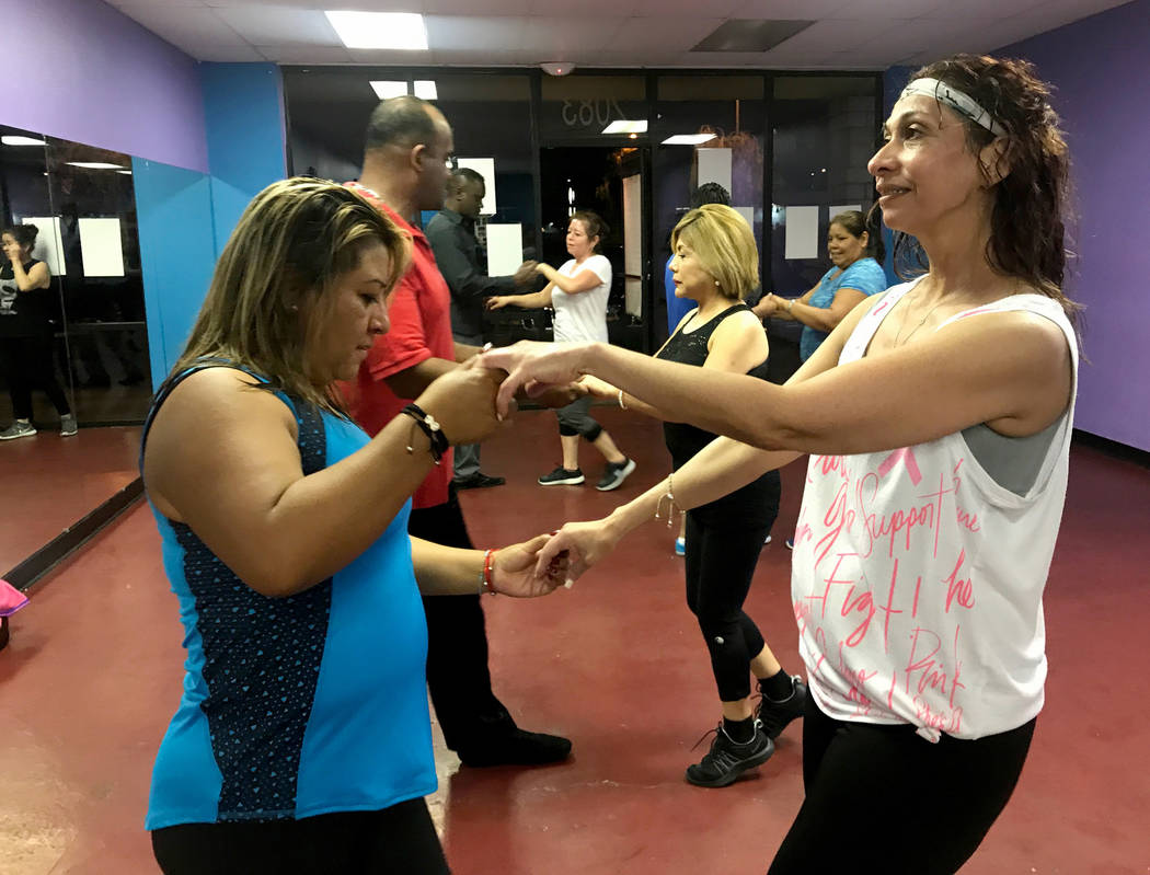 Sonia Dominguez, left, and Norme Valle, right, partner up during Jose Velez' salsa dancing class  April 24, 2017, at Family Fitness Zum, 2083 N. Jones Blvd. Kailyn Brown/View