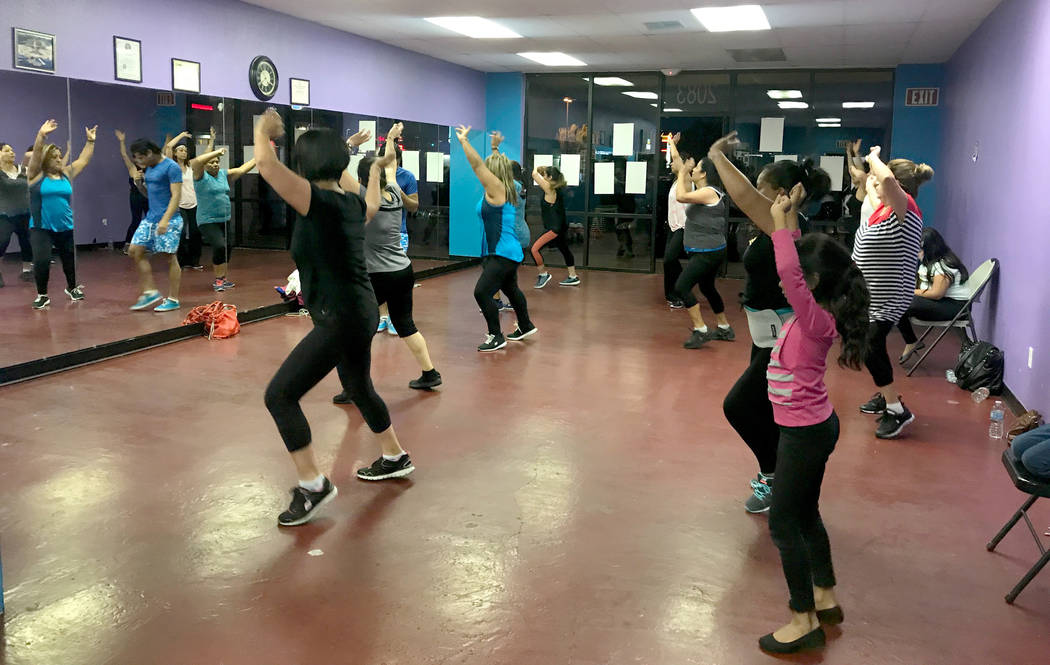 Danny Yemaya, owner of Family Zum Fitness, instructs zumba class April 24, 2017, at 2083 N. Jones Blvd. Kailyn Brown/View