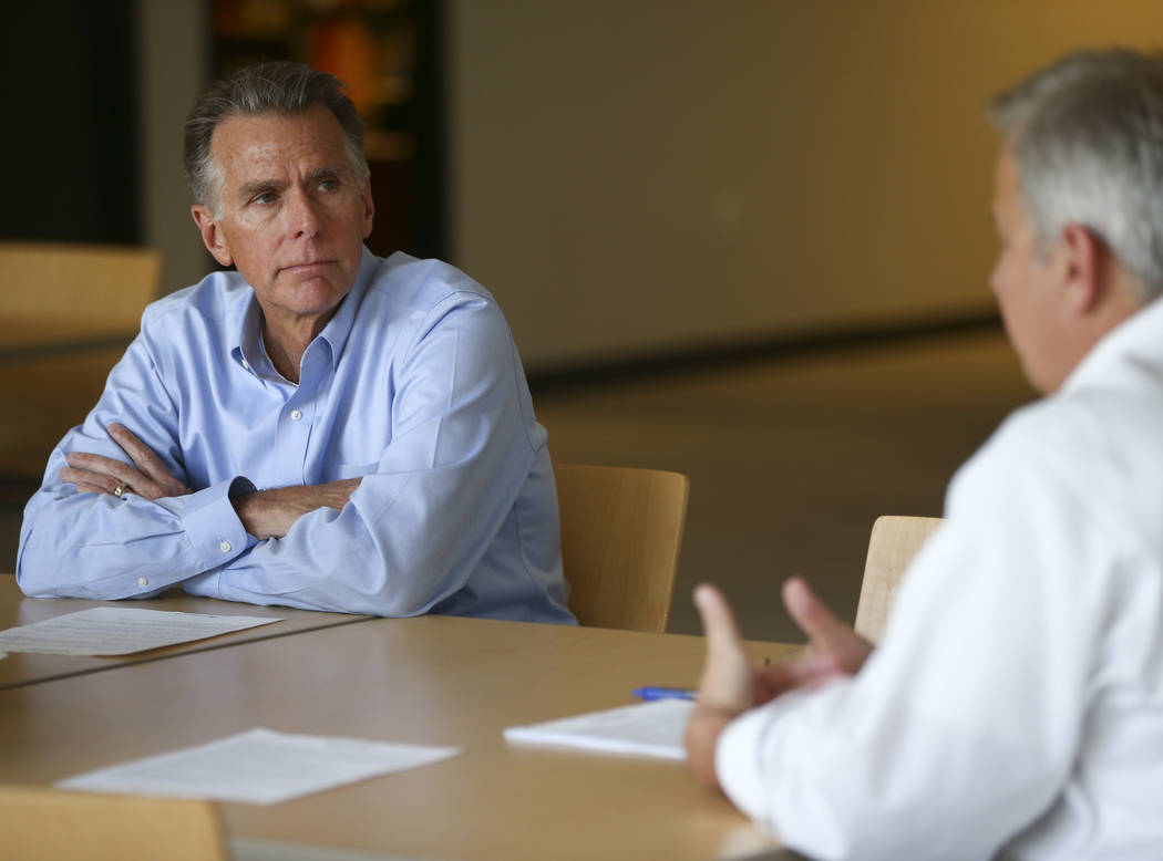 Rex Miller, managing director of TGG Accounting, left, listens as Jeremy Hauser, vice president of entrepreneurial & empowerment leadership at the Public Education Foundation, talks about the  ...