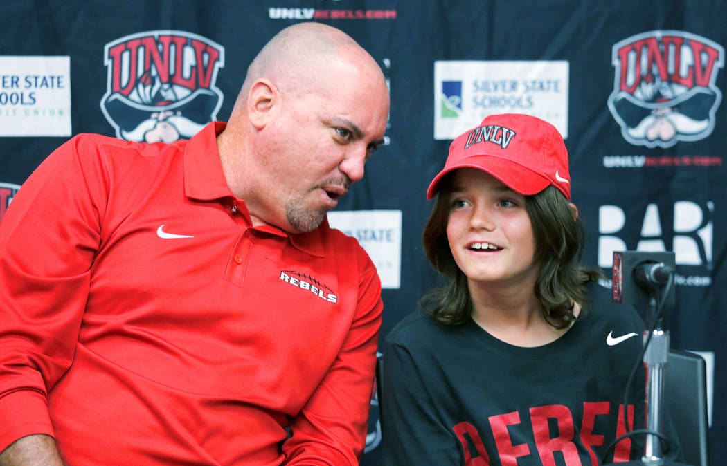 UNLV football coach Tony Sanchez speaks to Thaddeus Thatcher, 9, who is battling cancer, during a news conference at UNLV in Las Vegas, Monday, May. 1, 2017.  Chitose Suzuki Las Vegas Review-Journ ...