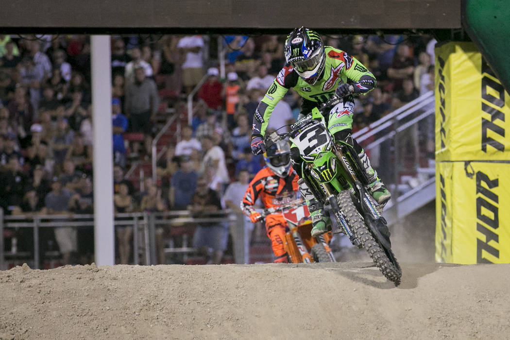 Racer Eli Tomac (3) makes his way around the course while Ryan Dungey (1) trails close behind during the Monster Energy AMA Supercross 450SX championship race at Sam Boyd Stadium on Saturday, May  ...