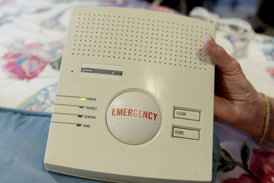 Roseanne Davis, 75, holds her medical alert device in her home in Las Vegas, Thursday, April 27, 2017. Elizabeth Brumley Las Vegas Review-Journal @EliPagePhoto