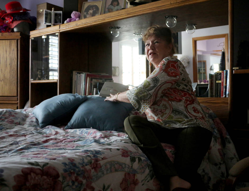 Roseanne Davis, 75, shows her medical alert device in her home in Las Vegas, Thursday, April 27, 2017. Emma Blanchfield Las Vegas Review-Journal