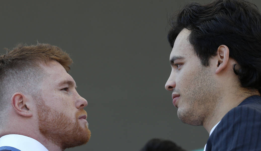 "Mexican boxers Saul ""Canelo"" Alvarez, left, and Julio Cesar Chavez Jr., are presented during a press conference in Mexico City, Monday, Feb. 20, 2017. Alvarez and Chavez were fac ..."