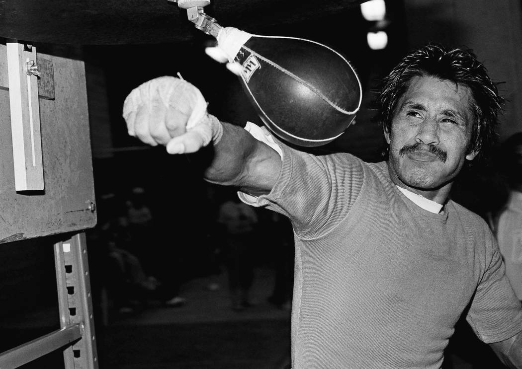 WBC World Bantamweight Champion Lupe Pinter of Mexico works on the speed bag as he gets ready for his title fight in the Superdome Friday, Dec. 2, 1982 in New Orleans. Pintor will be trying to cla ...