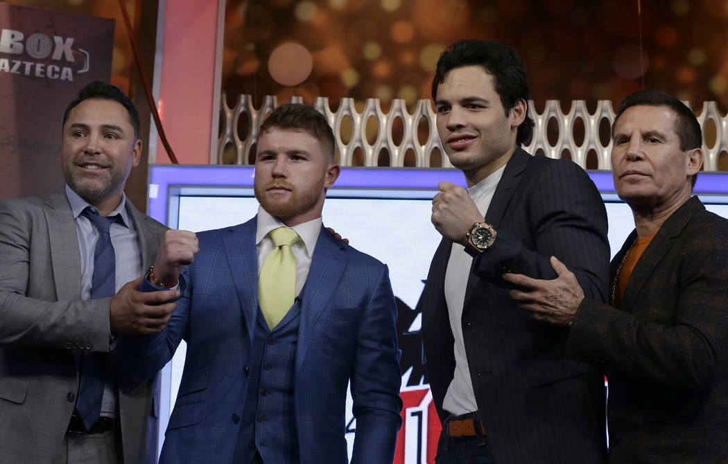 "Mexican boxers Saul ""Canelo"" Alvarez, second left, and Julio Cesar Chavez Jr., second right are presented during a press conference in Mexico City, Monday, Feb. 20, 2017. Alvarez ..."