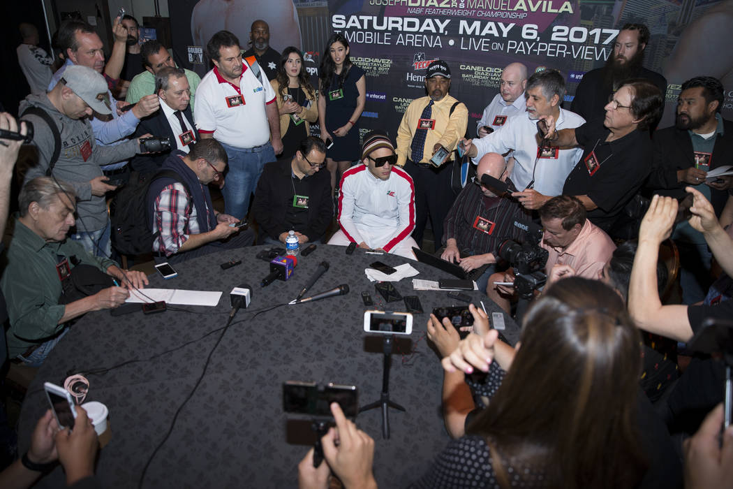 "Julio Cesar Chavez Jr., center, is interviewed about his upcoming fight, at MGM Grand hotel-casino on Wednesday, May 3, 2017, in Las Vegas. Chavez Jr. will fight Saul ""Canelo"" Al ..."