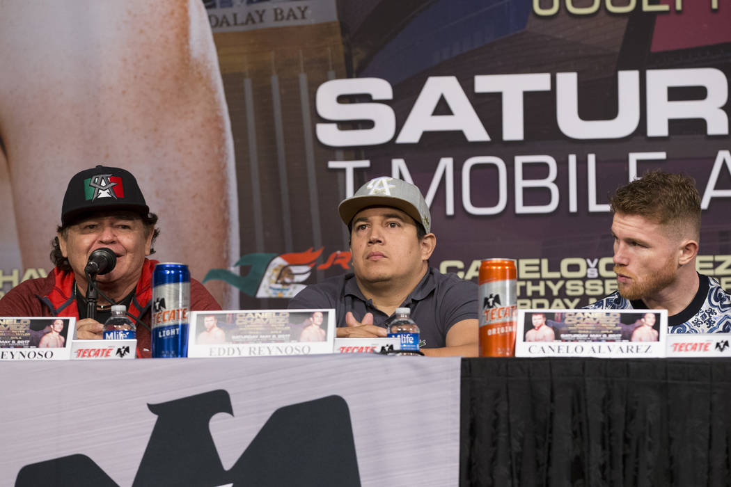 "Boxing trainers Jose ""Chepo"" Reynoso, from left, his son Eddy and their boxer Saul Canelo ""Canelo"" Alvarez, during a press conference at MGM Grand on Wednesday, ..."