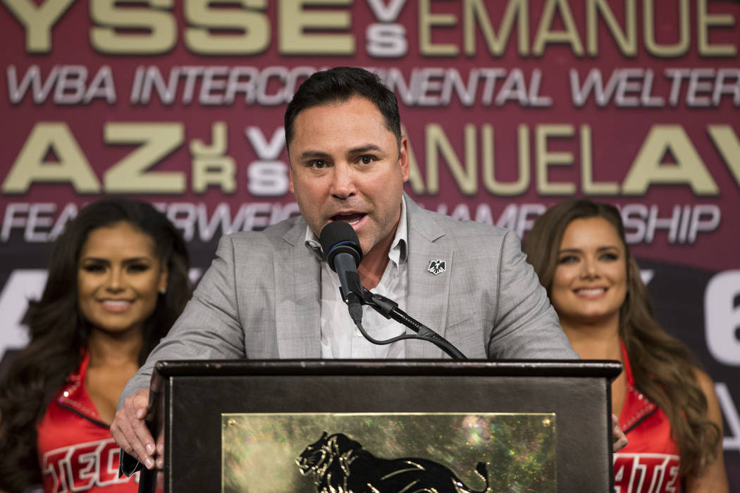 "Golden Boy Promotions CEO Oscar De La Hoya, center, speaks during the final boxing press conference before the fight between Saul Canelo ""Canelo"" Alvarez and Julio Cesar Chavez J ..."