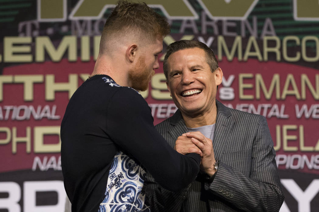 "Saul ""Canelo"" Alvarez, left, with Julio Cesar Chavez during a press conference at MGM Grand hotel-casino on Wednesday, May 3, 2017, in Las Vegas. Alvarez will fight Julio Cesar C ..."