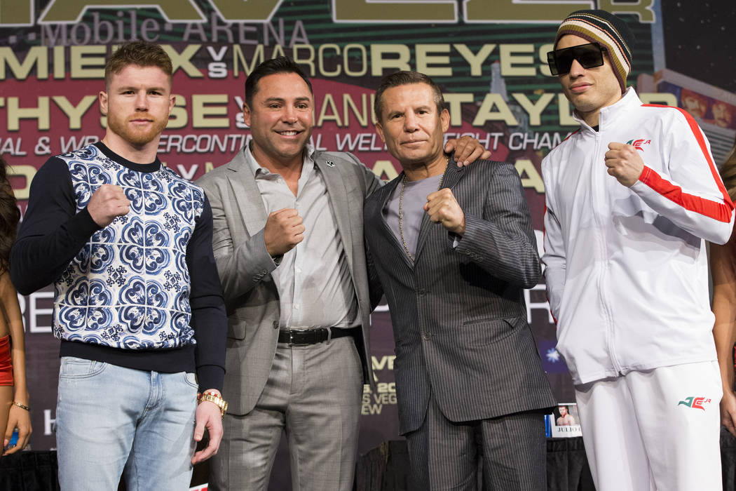 "Saul ""Canelo"" Alvarez, from left, Oscar De La Hoya, Julio Cesar Chavez and his son Julio Cesar Chavez Jr., during a press conference at MGM Grand hotel-casino on Wednesday, May 3 ..."