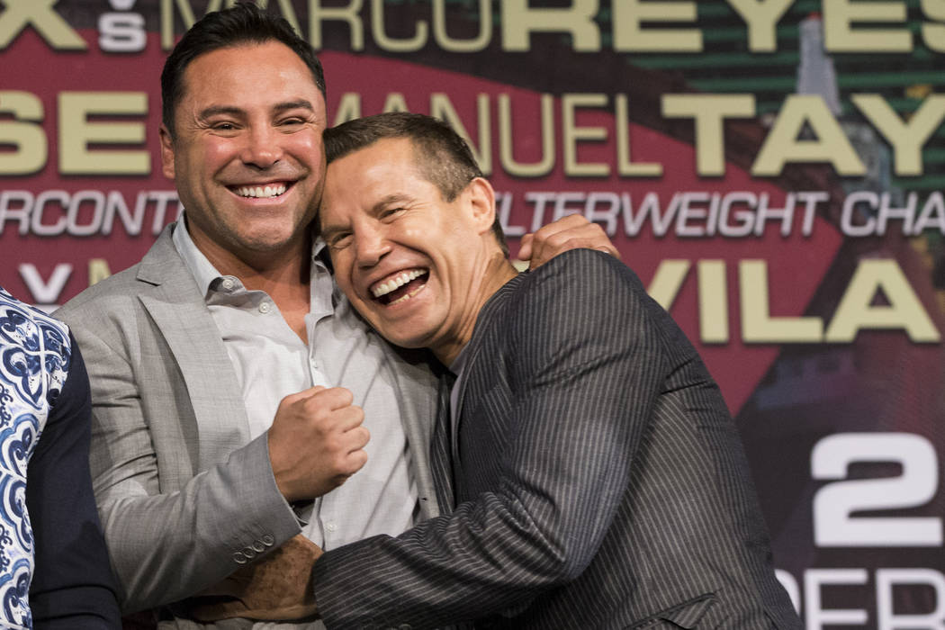 "Former Mexican boxers Oscar De La Hoya, left, and Julio Cesar Chavez during a press conference at MGM Grand hotel-casino on Wednesday, May 3, 2017, in Las Vegas. Saul ""Canelo"" Al ..."