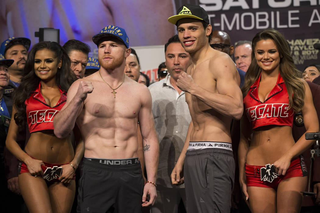 Saul Canelo Alvarez, left, and Julio Cesar Chavez Jr. during the official weigh-in at MGM Grand Garden Arena on Friday, May 5, 2017, in Las Vegas. The two will fight on May 6 in a catch weight fig ...