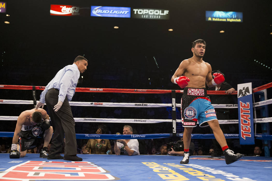 Jesus Rojas, right, after knocking down Abraham Lopez in the WBA NABA featherweight title bout at MGM Grand Garden Arena on Friday, May 5, 2017, in Las Vegas. Rojas won by knockout in the eight ro ...