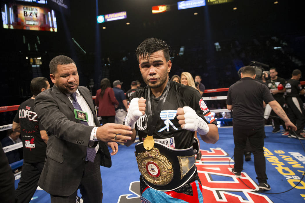 Jesus Rojas celebrates his win against Abraham Lopez in the WBA NABA featherweight title bout at MGM Grand Garden Arena on Friday, May 5, 2017, in Las Vegas. Rojas won by knockout in the eight rou ...