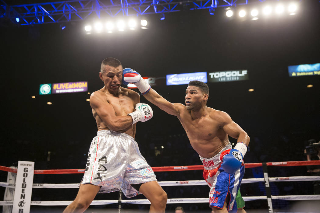 Yuriorkis Gamboa, right, connects a punch against Robinson Castellanos in the lightweight bout at MGM Grand Garden Arena on Friday, May 5, 2017, in Las Vegas. Castellanos won after Gamboa's corner ...