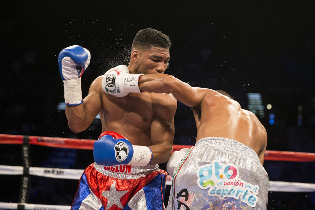 Robinson Castellanos, right, connects a punch against Yuriorkis Gamboa in the lightweight bout at MGM Grand Garden Arena on Friday, May 5, 2017, in Las Vegas. Castellanos won after Gamboa's corner ...