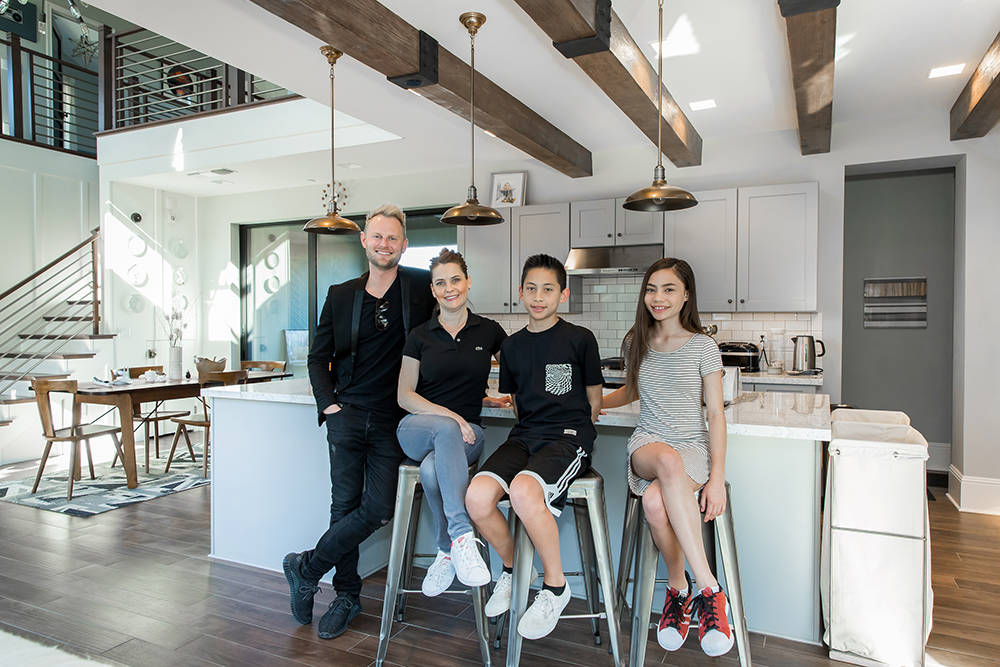 "Celebrity Designer Bobby Berk, left, meets with Pardee ""Farmhouse Family"" members Judi, Julian and Ella Santiago, during a recent visit to the new Pardee Homes Strada neighborhood in Inspirada ..."
