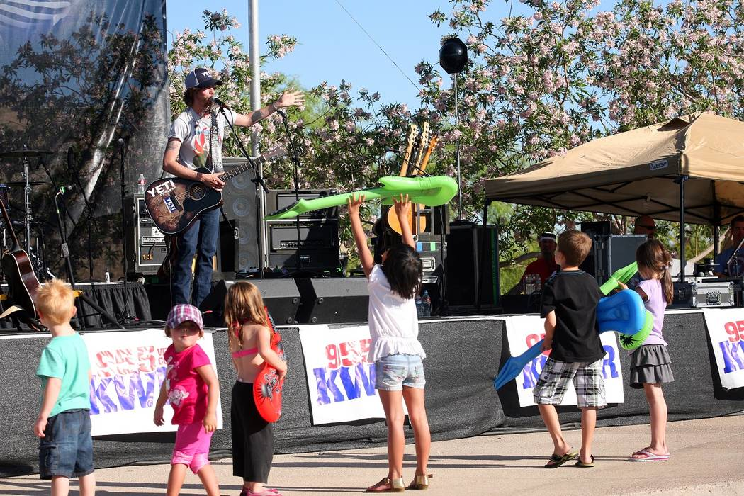 Kids enjoy the family-friendly Country in the Park event and performances. This year's free event is May 13 at Mountain's Edge. (Jim Laurie)