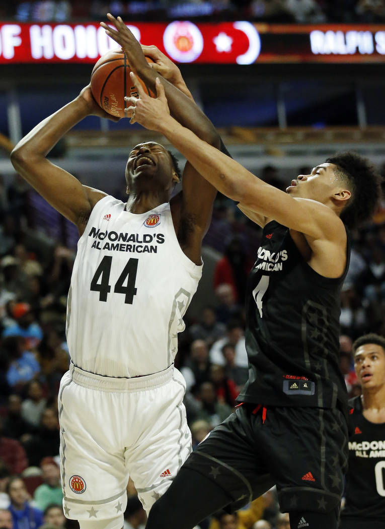 Big West's Brandon L. McCoy, left, shoots against Big East's Nicholas Richards during the first half of the McDonald's All- American boys high school basketball game in Chicago, Wednesday, March 2 ...