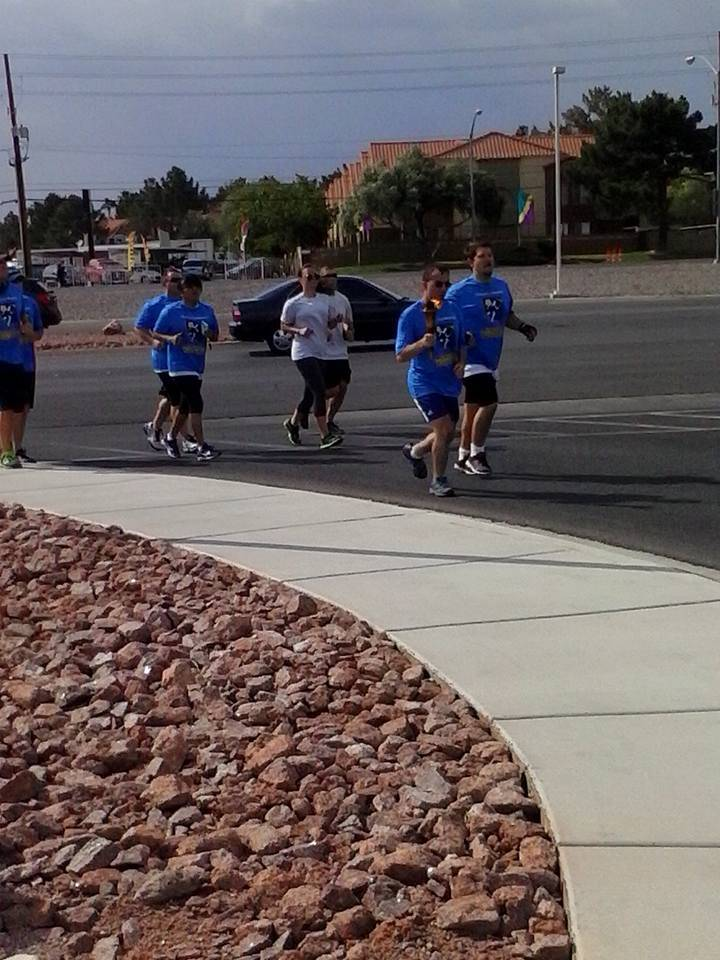 Matthew Migliore, other athletes and law enforcement participate in the Special Olympics Nevada Law Enforcement Torch Run in 2016. (Courtesy Facebook)