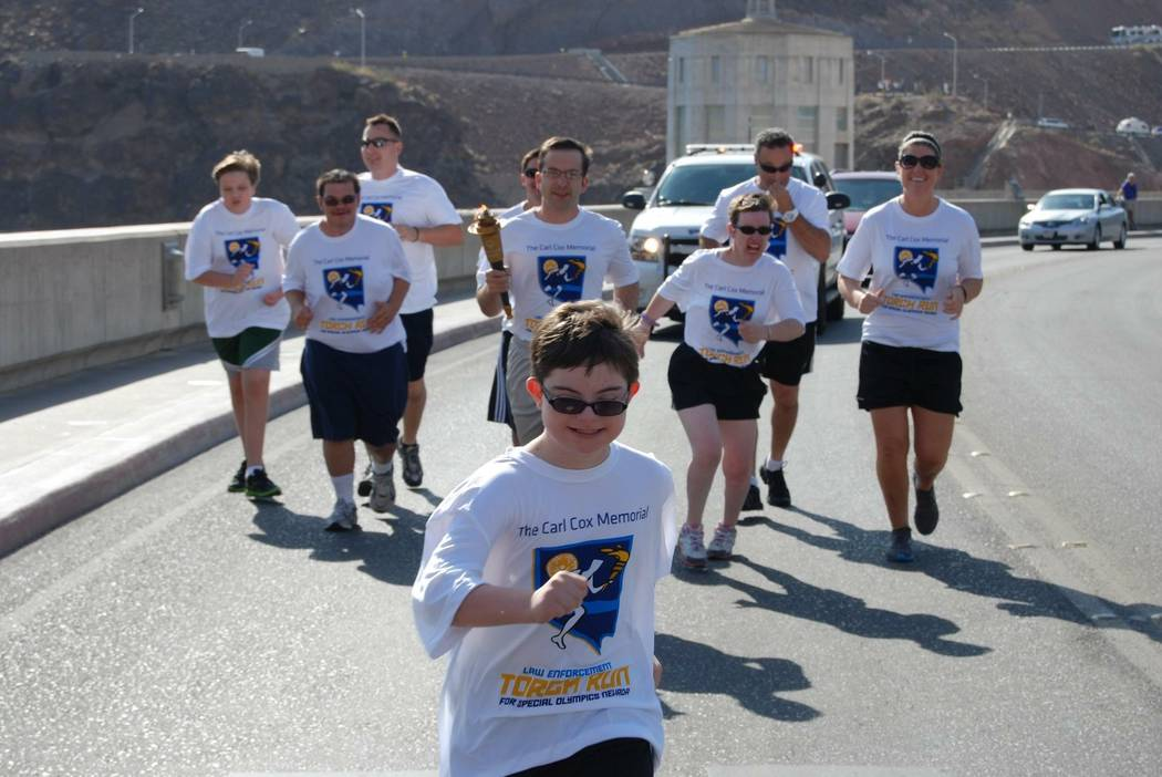 Special Olympics Nevada athletes participate in the Law Enforcement Torch Run. (Courtesy)