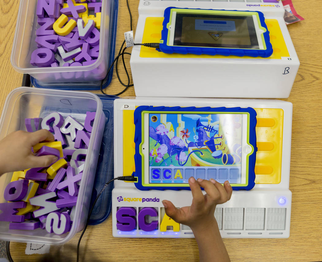 "A pre-kindergarten student uses the ""multisensory phonics system,"" Square Panda at Gene Ward Elementary School in Las Vegas, May 1, 2017. Elizabeth Brumley Las Vegas Review-Journ ..."