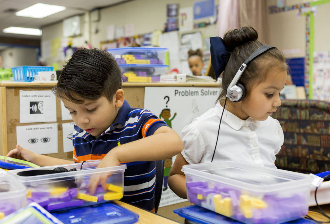 "Pre-kindergarten students Ezekiel, left, and Abigail, use the ""multisensory phonics system,"" Square Panda at Gene Ward Elementary School in Las Vegas, May 1, 2017. Elizabeth Brum ..."