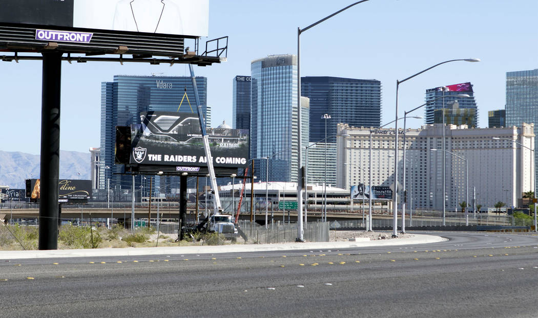 A Raiders billboard goes up on the northeast corner of Dean Martin Drive near Hacienda Avenue on Friday, April 21, 2017, at the proposed Russell Road stadium site in Las Vegas. Heidi Fang/Las Vega ...