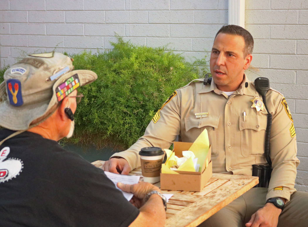 A Vietnam War veteran, left, speaks to Sgt. Steve Armbruster during Coffee with a Cop at the Donut Bar in downtown Las Vegas, Thursday, May 4, 2017. (Gabriella Benavidez/Las Vegas Review-Journal)  ...
