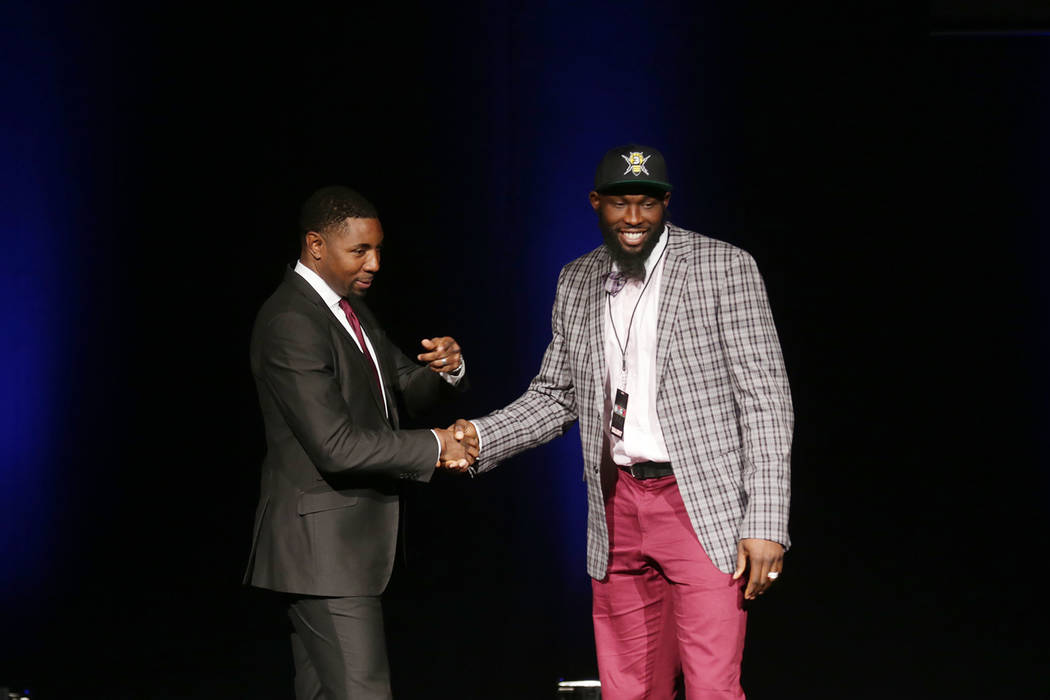 Reggie Evans, right, shakes hand with Roger Mason Jr. after being drafted for the Killer 3s team on Sunday, April 30, 2017, at the BIG3 inaugural draft at Planet Hollywood in Las Vegas. BIG3 is Ic ...