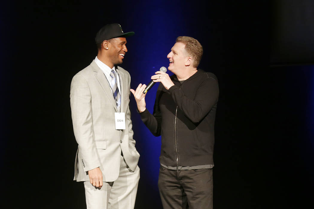 Derrick Byars, from left, talks to Michael Rapaport after being drafted for the Tri State team on Sunday, April 30, 2017, at the BIG3 inaugural draft at Planet Hollywood in Las Vegas. BIG3 is Ice  ...