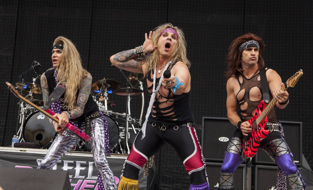 Lexxi Foxxx, Michael Starr and Satchel of Steel Panther perform at Rock on the Range on Sunday, May 19, 2013 in Columbus, Ohio. (Photo by Barry Brecheisen/Invision/AP Photo)