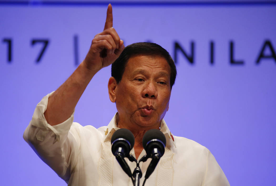 Philippines President Rodrigo Duterte gestures while addressing the media following the conclusion of the 30th ASEAN Leaders' Summit in Manila, Philippines, Saturday, April 29, 2017. Duterte sugge ...