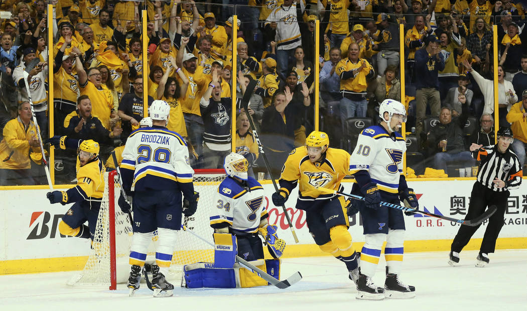Nashville Predators center Colton Sissons, left, and right wing Miikka Salomaki (20) react after teammate Cody McLeod scored against St. Louis Blues goaltender Jake Allen (34) in the second period ...