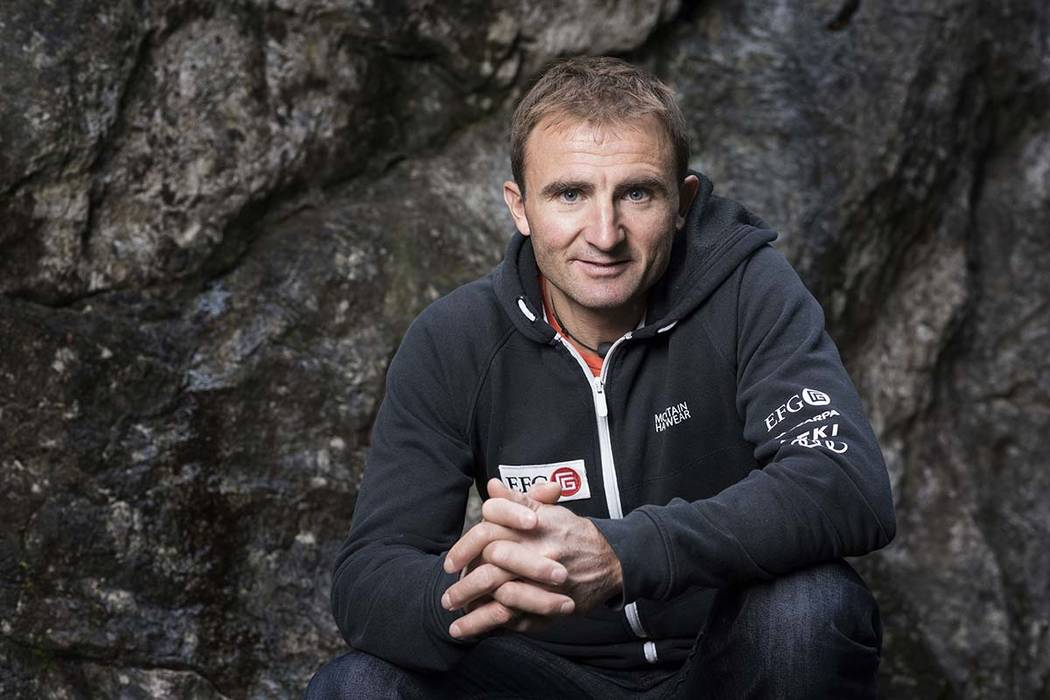 Swiss climber Ueli Steck poses for a photo at the foot of a climbing wall in Wilderswil, Canton of Berne, Switzerland. Expedition organizers say famed Swiss climber was killed in a mountaineering  ...