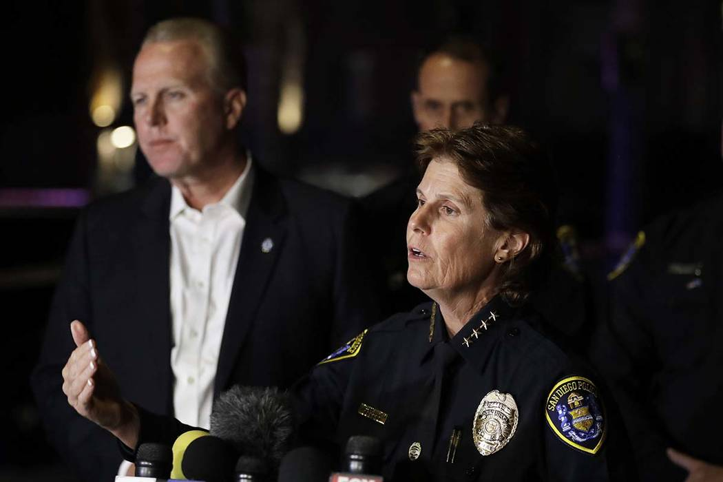 San Diego Police Chief Shelley Zimmerman speaks in front of a La Jolla apartment after a shooting Sunday, April 30, 2017, in San Diego as San Diego Mayor Kevin Faulconer looks on. (Gregory Bull/AP)