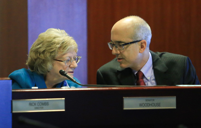 State Senators Joyce Woodhouse, left and Mo Denis talk to each other during a legislative committee meeting at the Grant Sawyer State Office Building on Friday, Jan. 27, 2017, in Las Vegas. Brett  ...