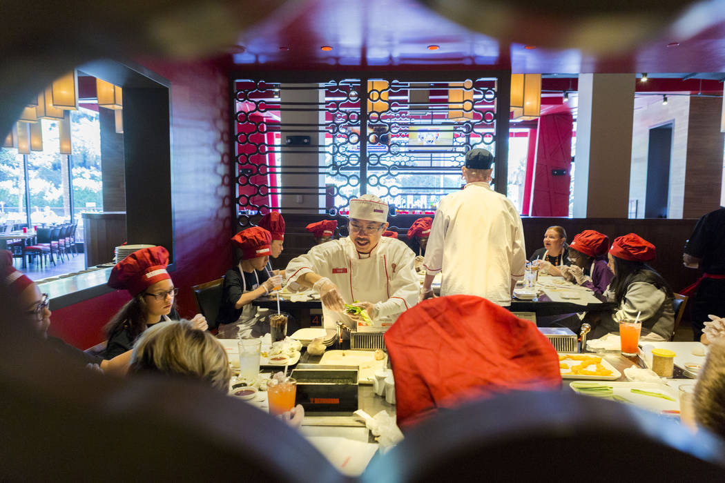 Benihana head sushi chef Vue Vang demonstrates how to roll sushi with students from Harney Middle School at Benihana inside Fashion Show mall in Las Vegas Tuesday, May 2, 2017. Elizabeth Brumley L ...
