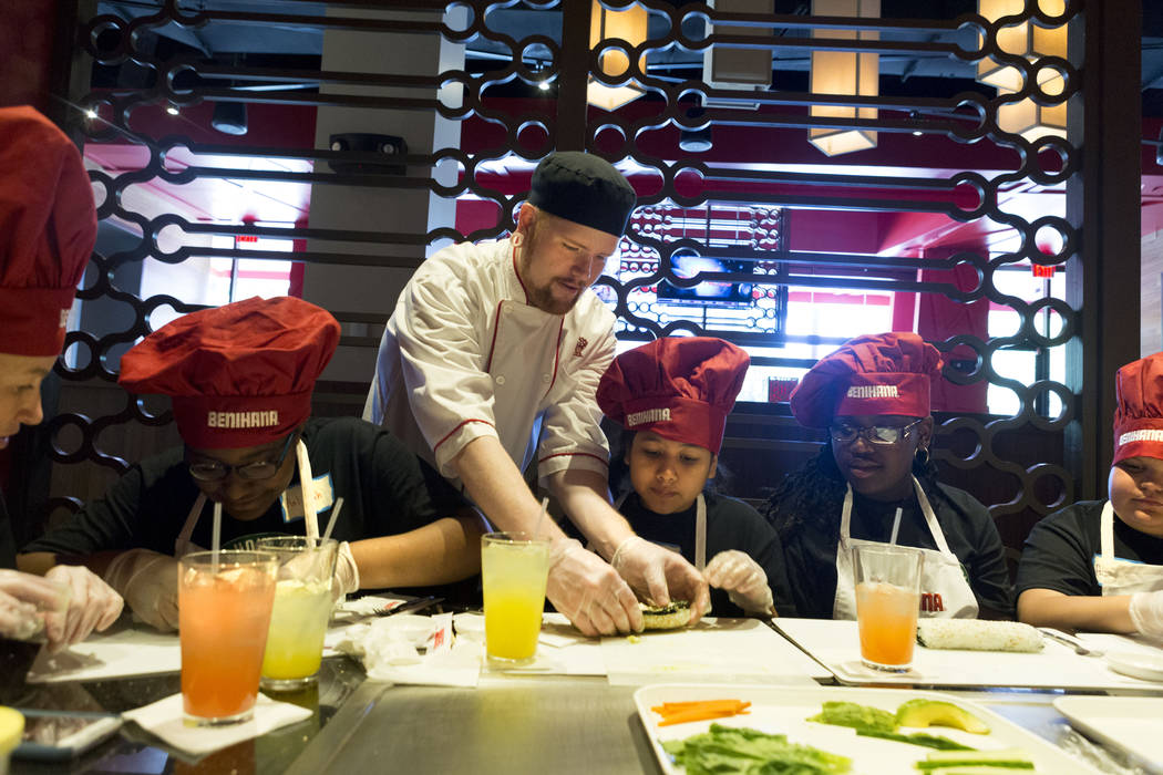 Sushi chef Robert Sharpsteen demonstrates how to roll sushi with students from Harney Middle School at Benihana inside Fashion Show mall in Las Vegas, Tuesday, May 2, 2017. Elizabeth Brumley Las V ...
