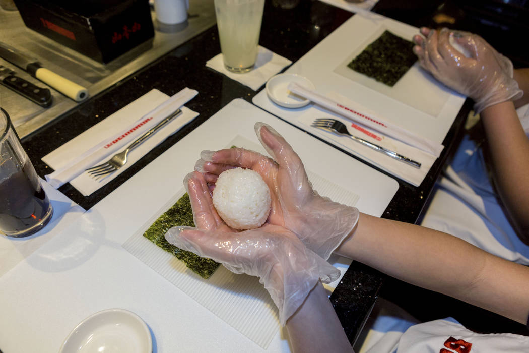 Rice for a California roll during a sushi rolling lesson for Harney Middle School students at Benihana inside of Fashion Show mall in Las Vegas, Tuesday, May 2, 2017. Elizabeth Brumley Las Vegas R ...