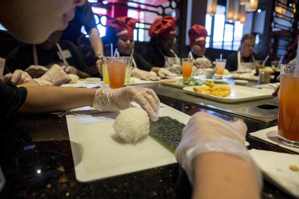 Harney Middle School make hand rolls as learning to make different kinds of sushi rolls at Benihana inside of Fashion Show mall in Las Vegas, Tuesday, May 2, 2017. Elizabeth Brumley Las Vegas Revi ...
