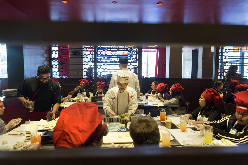 Sushi chef Erica Perez demonstrates how to roll sushi with students from Harney Middle School at Benihana inside Fashion Show mall in Las Vegas Tuesday, May 2, 2017. Elizabeth Brumley Las Vegas Re ...