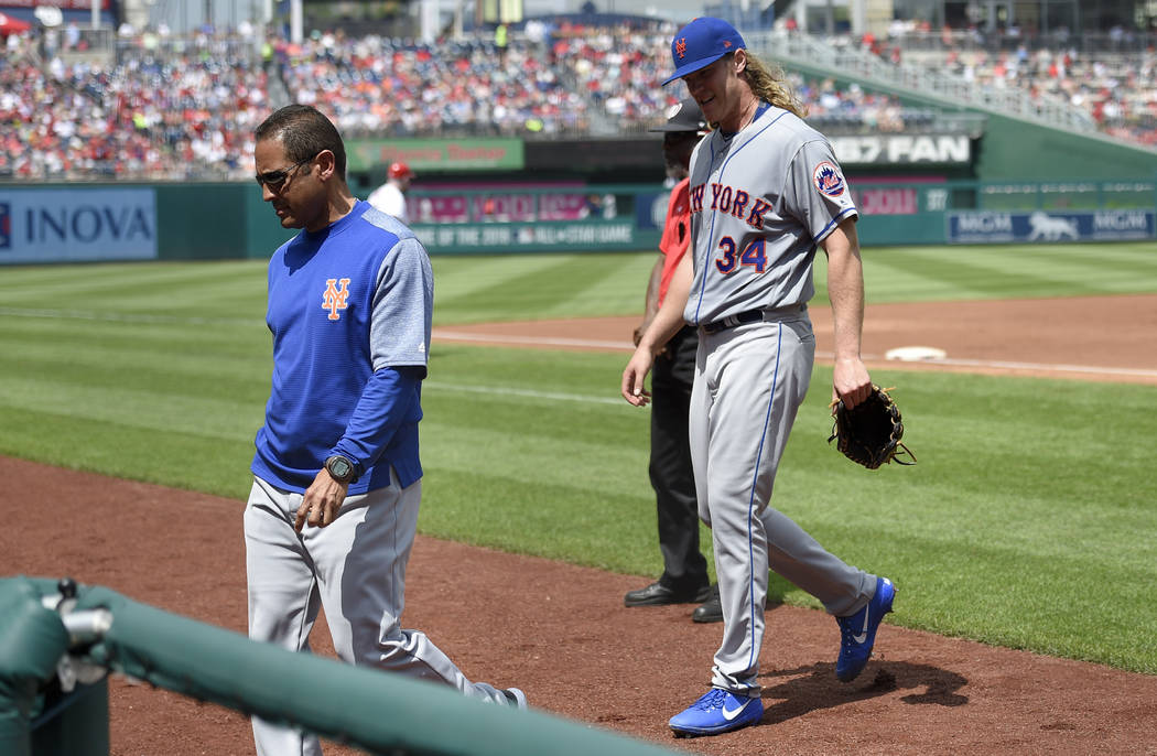 New York Mets starting pitcher Noah Syndergaard (34) leaves a baseball game with an injury during the second inning against the Washington Nationals, Sunday, April 30, 2017, in Washington. (AP Pho ...