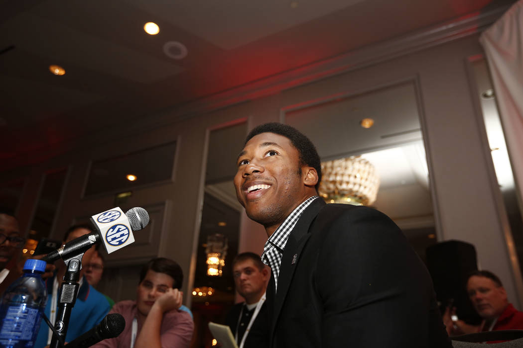 FILE - In this July 12, 2016, file photo, Texas A&M defensive linebacker Myles Garrett speaks to the media at the Southeastern Conference NCAA college football media days, in Hoover, Ala. Garr ...