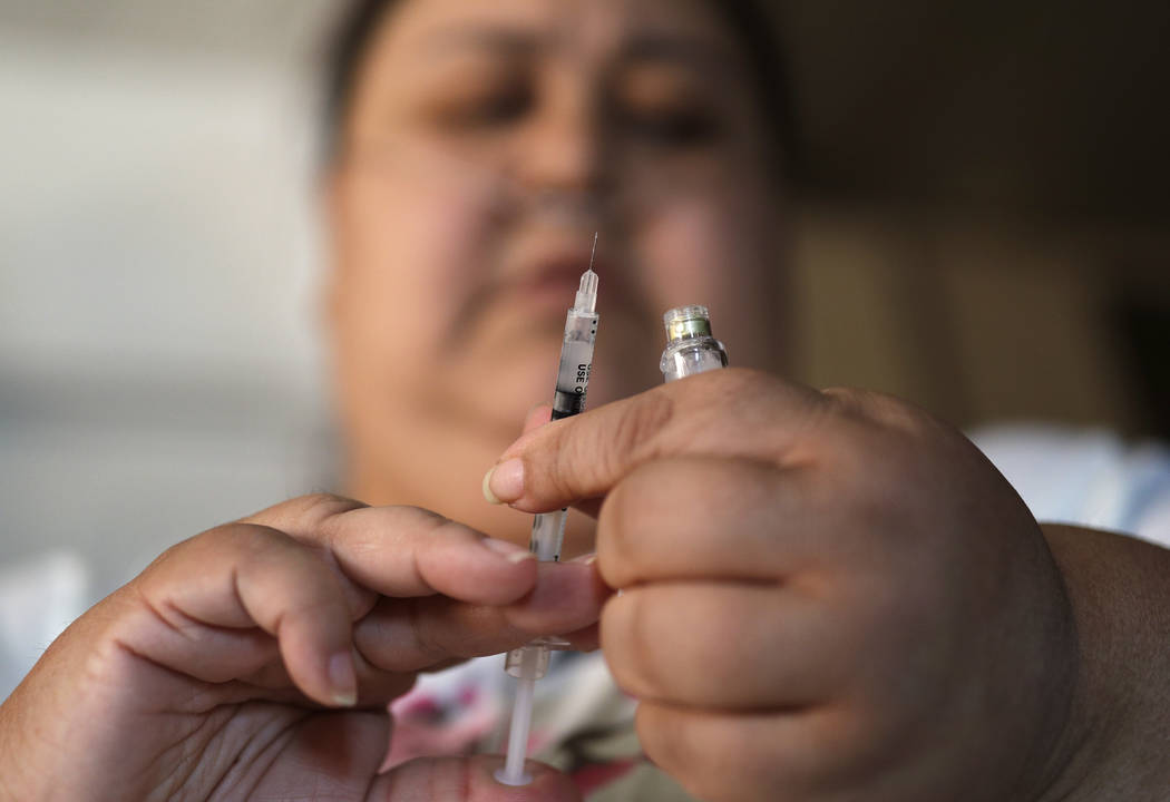 In this April 18, 2017, photo, Soila Solano prepares to inject herself with insulin at her home in Las Vegas. Solano was diagnosed with Type 2 diabetes six years ago. Casino owners and their emplo ...