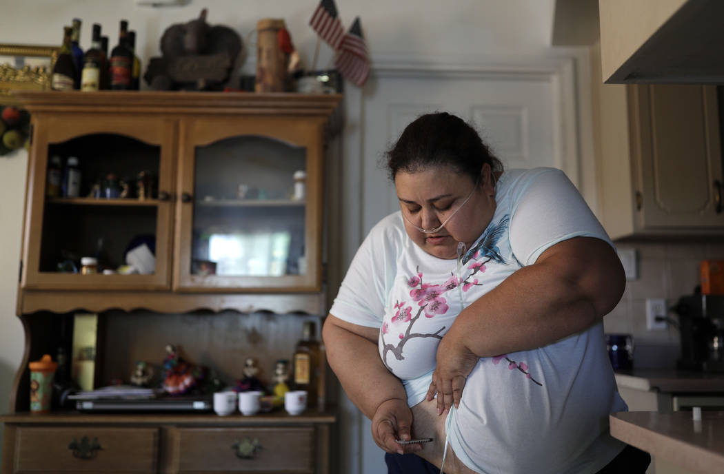 Soila Solano injects herself with insulin at her home in Las Vegas. Solano was diagnosed with Type 2 diabetes six years ago. John Locher AP