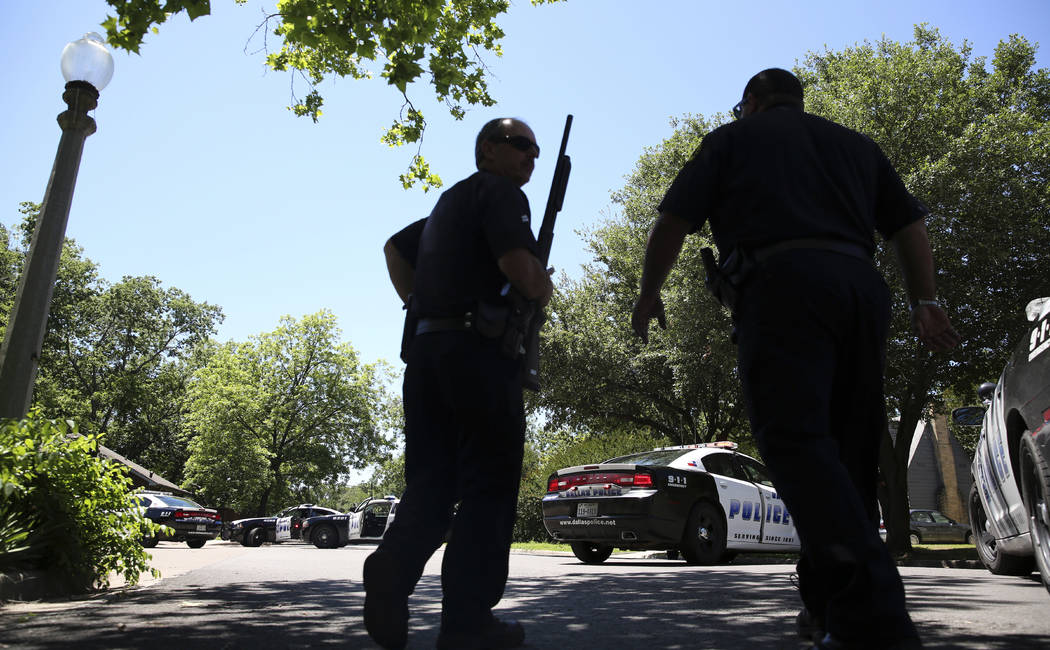 Dallas Police walk a neighborhood a block away from a shooting in Dallas, Monday, May 1, 2017. Authorities said a Dallas paramedic has been shot while responding to a shooting call. (LM Otero/AP)
