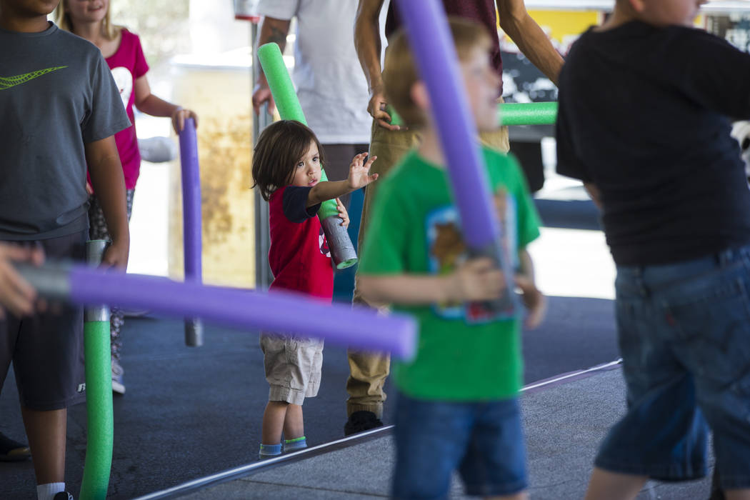 """Ryder Caldera, 3,  looks to use the """"force"""" during the """"May Science Be With You"""" event, held by the National Atomic Testing Museum and the Desert Research Insti ..."""